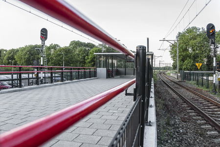 view of a trainstation with red railing to the left
