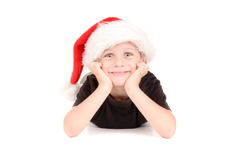 little boy with christmas hat isolated in white background