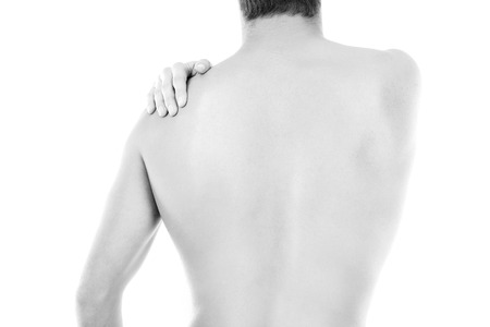 young man with back pain isolated in white