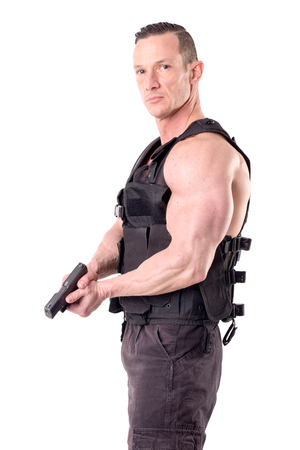 Photo for tactical law enforcer posing isolated in white - Royalty Free Image