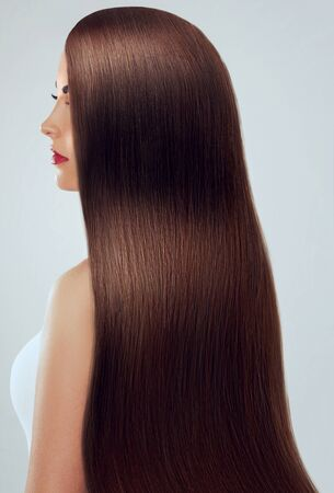 Photo pour Beautiful Hair. Beauty woman with luxurious long hair. Beauty Model Girl with Healthy brown Hair. Pretty female with long smooth shiny straight hair. Hairstyle. Keratin straightening. - image libre de droit