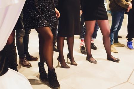Photo pour Perfect female legs wearing high heels and black dress - image libre de droit