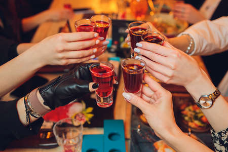 Photo for Clinking glasses with alcohol and toasting, party. - Royalty Free Image
