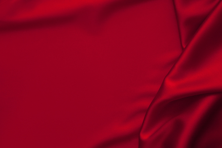 Photo pour Luxury red shiny satin fabric cloth abstract wavy background - image libre de droit