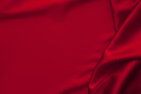 Foto de Luxury red shiny satin fabric cloth abstract wavy background - Imagen libre de derechos