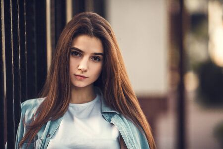 Photo for Fashion hipster cool girl relaxing on city street. Pensive female hipster model. Summer sunkight portrait - Royalty Free Image