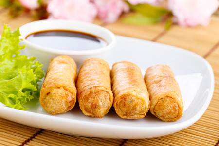 fresh spring rolls with vegetables on chinese dishware.の写真素材