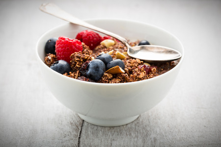 Cereals and flakes with nuts and fresh berries.