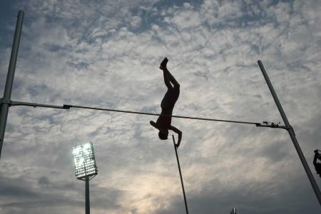 THESSALONIKI, GREECE - SEPT 12,2009:Female pole vault final silhouette at the IAAF 2009 World Athletics Final in Kaftatzoglio stadium