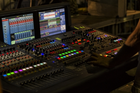 A mixing console, or audio mixer,shallow dof