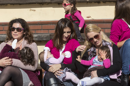 Thessaloniki, Greece, November 1 2015: Mother breastfeeding her baby on the 6th Nationwide public breastfeeding in celebration of World Breastfeeding Week