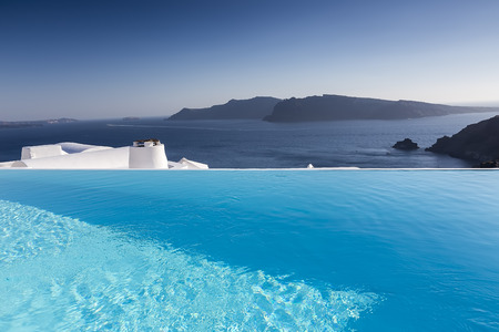 Luxury resort swimming pool in Santorini, Greece