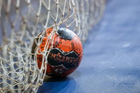 Photo pour Thessaloniki, Greece - February 13, 2016: Handball ball on the goalpost net prior to the Greek Women Cup Final handball game Arta vs Nea Ionia - image libre de droit