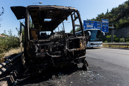 Thessaloniki, Greece - June 25, 2017: A tourist bus got fire and burned completely on the peripheral road of Thessaloniki. Passengers have been taken safely and harmless