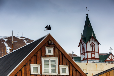 Husavik, Iceland - March 29, 2017: The part of the town Husavik in the north-west Iceland, with in the main point a white wooden church