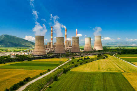 Photo pour Aerial view the plant producing electrical energy with large pipes at Kozani in northern Greece. - image libre de droit