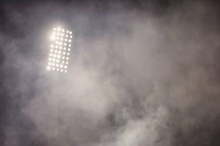 Photo pour soccer stadium lights reflectors with smoke. football field - image libre de droit