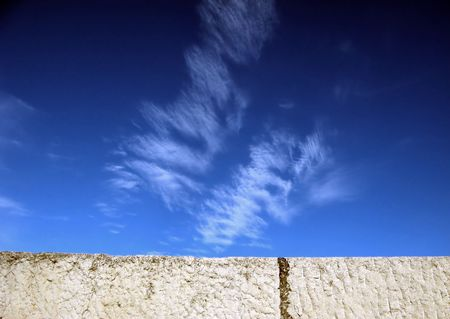 Cloudscape beyond a wall