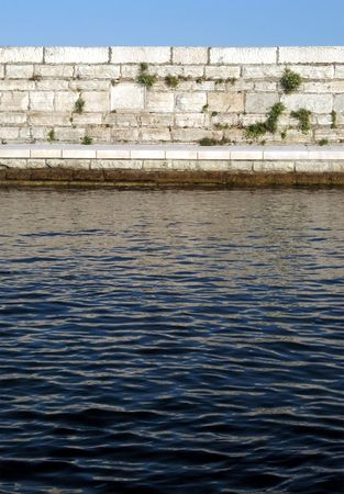 Ancient wall with water surface