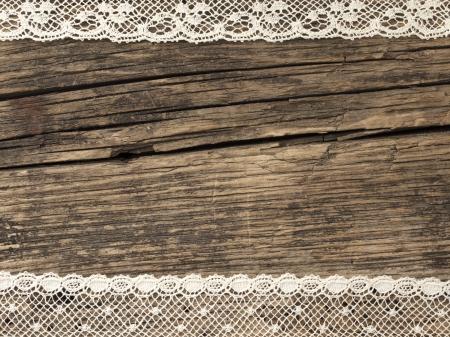 Photo pour vintage lace on the wooden background - image libre de droit