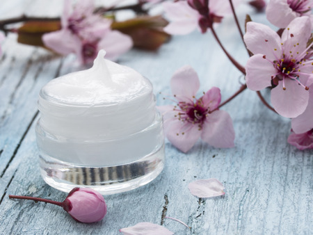 Photo for natural facial cream with spring flowers decoration - Royalty Free Image