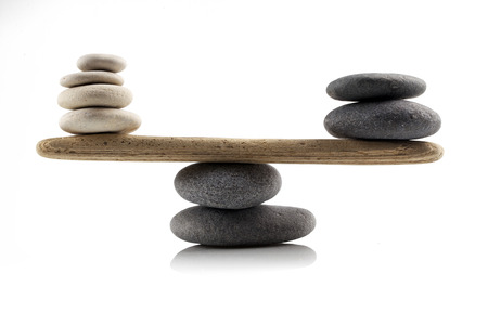 balancing stones on white background