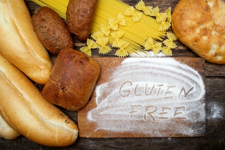 gluten free  word with bread on wood background
