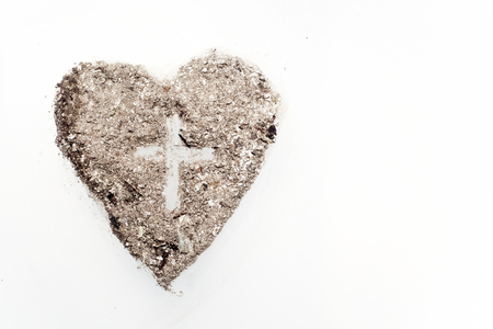 Photo for Cross or crucifix in heart symbol made of ash, lent and Ash Wednesday concept - Royalty Free Image