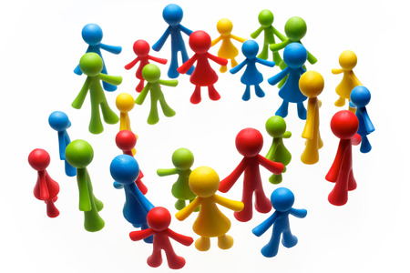 Photo pour Colorful painted group of people figures on white background - image libre de droit