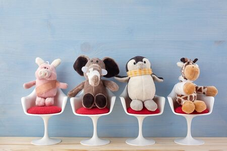 Foto de Pediatrician. Toy animals sitting on the chair in hospital. Health center for children. Blue background - Imagen libre de derechos
