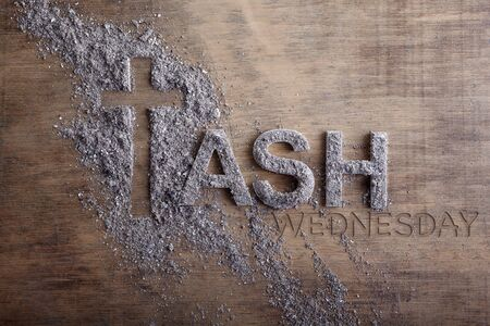 Photo for Ash wednesday word written in ash and christian cross symbol as a religion concept - Royalty Free Image