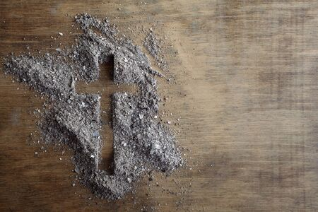 Photo for Christian cross symbol made of ash on a wooden background - Royalty Free Image