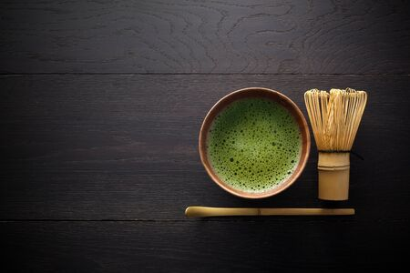 Photo for Matcha powder. Organic green matcha tea ceremony. Healthy drink. Traditional japanese drink on black wooden background - Royalty Free Image