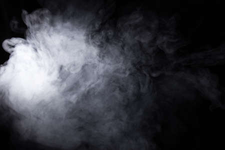 Foto de Cloud of white smoke on a black background closeup - Imagen libre de derechos