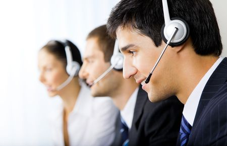 Photo pour Three support phone operators at workplace - image libre de droit