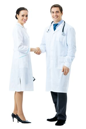 Full body portrait of two medical people handshaking, isolated on white background