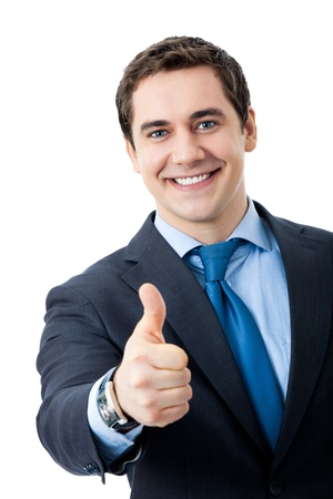 Happy smiling young business man with thumbs up gesture, isolated over white backgroundの写真素材