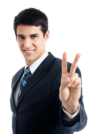 Happy smiling young business man showing two fingers or victory gesture, isolated over white backgroundの写真素材