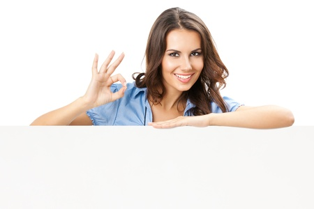 Happy smiling beautiful young woman showing blank signboard or copyspace, isolated over white background