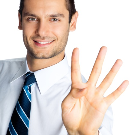 Portrait of happy smiling businessman showing four fingers, isolated over white background