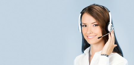 Photo for Portrait of happy smiling cheerful customer support phone operator in headset, over blue background - Royalty Free Image