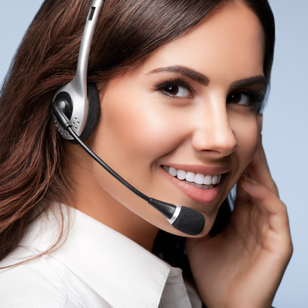 Photo pour customer support phone operator in headset, against grey background. Consulting and assistance service call center. - image libre de droit