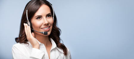Photo pour Customer support female phone operator in headset, with copyspace, on grey background. Consulting and assistance service call center. - image libre de droit