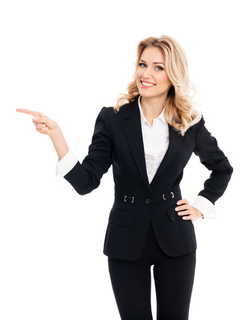 Foto de Happy smiling young businesswoman, showing something, some product or blank copyspace area for advertise slogan or text message, on white background. Caucasian blond model in business success concept. - Imagen libre de derechos