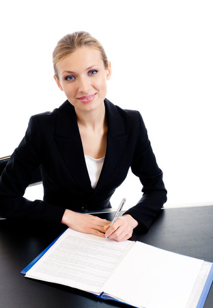 Young happy smiling businesswoman writing, isolated on white background. Success in business concept studio shot.