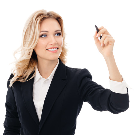 Photo pour Happy smiling cheerful young businesswoman writing or drawing something on screen or transparent glass, by blue marker, isolated over white background - image libre de droit