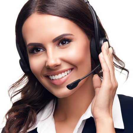 Photo pour Portrait photo of smiling customer support phone operator, isolated against white background - image libre de droit