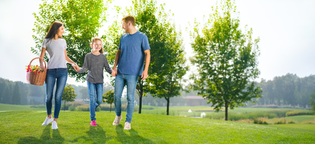 Photo pour Photo of going on picnic happy family, countryside or park. Happy childhood and summertime concept image. Copy space empty place for some text, advertising or slogan. Sunny day picture. - image libre de droit