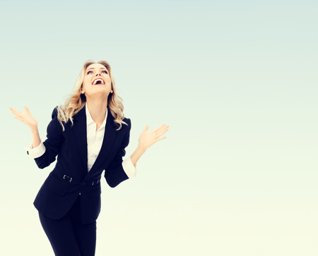 Photo for Photo of happy gesturing young cheerful businesswoman, with blank copyspace area for text or slogan - Royalty Free Image