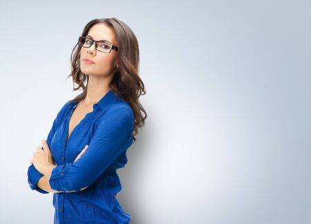Foto de Portrait of happy smiling young businesswoman in glasses, corporate style, with blank copy space area for slogan or text - Imagen libre de derechos